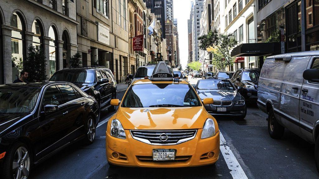 a yellow car in traffic